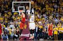 Mo Williams of the Cleveland Cavaliers shoots makes the 25th record-setting three point shot of the game over Mike Muscala of the Atlanta Hawks during the NBA Eastern Conference semifinals