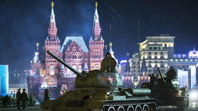 World War II era Soviet tanks T-34 make their way through the Red Square during a rehearsal for the Victory Day military parade which will take place at Moscow's Red Square on May 9 to celebrate 70 years of the victory in the WWII in Moscow, Russia, Tuesday, May 5, 2015. (AP Photo/Pavel Golovkin)