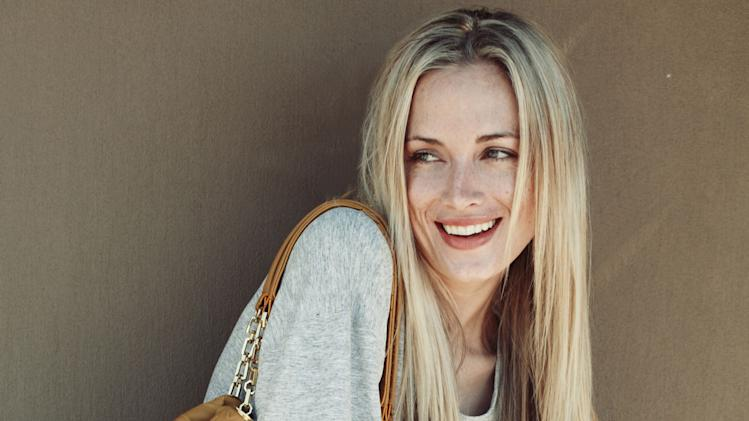 This is an undated portfolio photo supplied by Ice Model Management in Johannesburg of Reeva Steenkamp,  during a photo shoot. Paralympic superstar Oscar Pistorius was charged Thursday, Feb. 14, 2013, with the murder of his girlfriend who was shot inside his home in South Africa, a stunning development in the life of a national hero known as the Blade Runner for his high-tech artificial legs.  Reeva Steenkamp, a model who spoke out on Twitter against rape and abuse of women, was shot four times in the predawn hours in the home, in a gated community in the capital, Pretoria, police said.  (AP Photo/Ice Model Management) EDITORIAL PURPOSE ONLY