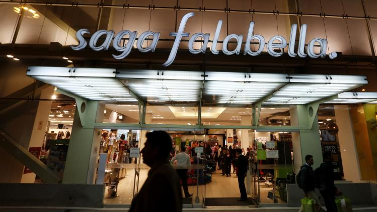 People walk past a Saga Falabella department store in the Miraflores district of Lima