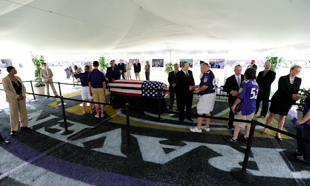Football fans file past the casket of former Baltimore Ravens owner Art Modell during a public viewing at M&T Bank Stadium in Baltimore, Saturday, Sept. 8, 2012. Modell died Sept. 6. He was 87. (AP Photo/Steve Ruark)