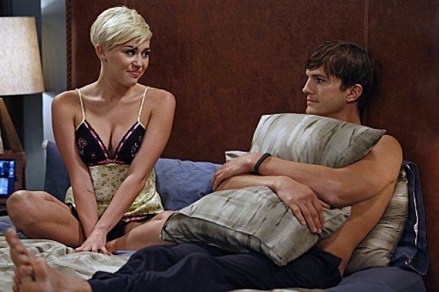 Miley Cyrus as Missi and Ashton Kutcher As Walden S. Schmidt in &#39;Two and a Half Men,&#39; Oct. 2012 -- CBS