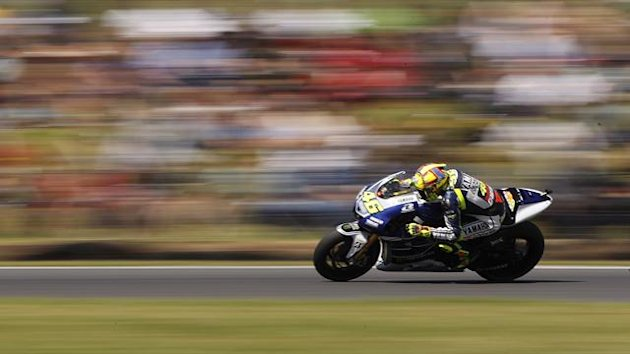 Yamaha MotoGP rider Valentino Rossi of Italy rides during the fourth free practice session ahead of the Australian Motorcycle Grand Prix, at Phillip Island Circuit October 19, 2013 (Reuters)