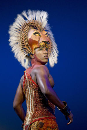 "In this theater publicity image released by Disney Theatrical Productions, Dashaun Young portrays Simba in the Broadway production of ""The Lion King,"" in New York. The Lion King"" has more reason to roar - it's on pace to end the week as the first Broadway show to earn $1 billion. (AP Photo/Disney Theatrical Productions, Joan Marcus, File)"