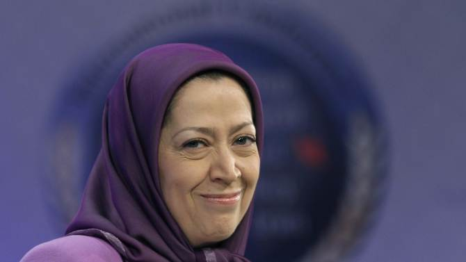 FILE - In this Jan. 25, 2011 file photo, Maryam Rajavi, President-elect of Iranian opposition party National Council of Resistance of Iran, smiles as she attends an international conference on Iran policy in Brussels. Maryam Rajavi, the Paris-based head of the exiled opposition group, said in an interview that she hopes the organization can now have the ear of the world's diplomats to help bolster its bid to overthrow Iran's clerical regime. She stressed that its goal was to replace the Islamic Republic with a democratic government, Friday, Sept. 28, 2012. (AP Photo/Yves Logghe, File)