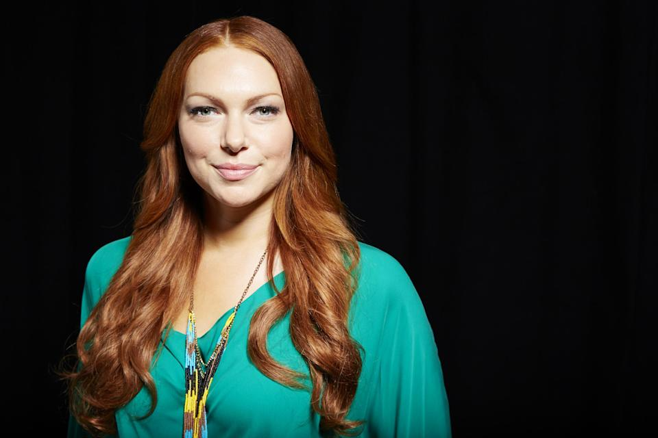 "This June 25, 2013 photo shows Laura Prepon, star of the Netflix original series, ""Orange Is The New Black,"" in New York. The series is based on a memoir of the same name by a woman named Piper Kerman, who spent one year in a women's correctional facility. (Photo by Dan Hallman/Invision/AP)"