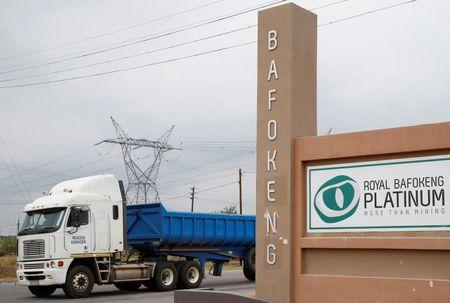 A truck drives past the entrance to the Royal Bafokeng Platinum Rasimone mine near Phokeng in the North West province