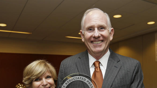 Miami coach Jim Larranaga and his wife Liz pose with the trophy after he was introduced as The Associated Press college basketball coach of the year on Thursday, April 4, 2013, in Atlanta. Larranaga led Miami to the Atlantic Coast Conference regular season and tournament titles and a No. 2 ranking. (AP Photo/John Bazemore)