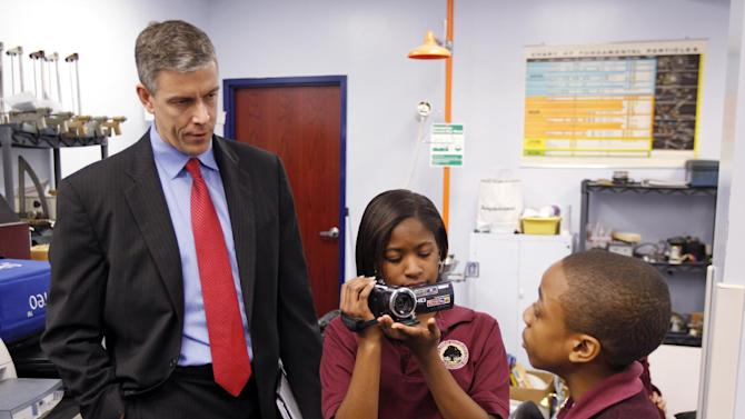 In this Friday, April 15, 2011 photo, U.S. Department of Education Secretary Arne Duncan is questioned by student Trebor Goodall, right, as he's videotaped by fellow student Faith Brown during a tour of the Charles A. Tindley Accelerated School in Indianapolis. Duncan is a chief proponent of extended hours and a longer school year. The school in Indianapolis has extended hours. (AP Photo/Michael Conroy)