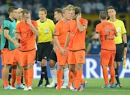 Dutch players react at the end of the Euro 2012 championships football match the Netherlands vs Germany on June 13, 2012 at the Metalist Stadium in Kharkiv.  Germany won 2-1   AFP PHOTO / PATRICK HERTZOGPATRICK HERTZOG/AFP/GettyImages