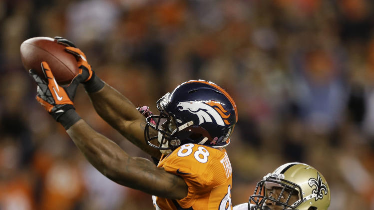 Denver Broncos wide receiver Demaryius Thomas (88) makes a leaping catch against New Orleans Saints cornerback Patrick Robinson (21) in the first quarter of an NFL football game, Sunday, Oct. 28, 2012, in Denver. (AP Photo/Jack Dempsey)
