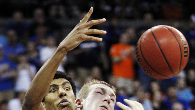 Kansas forward Kevin Young, rear, knocks the ball from Purdue forward Robbie Hummel (4) during the second half of a third round NCAA college basketball tournament game at CenturyLink Center in Omaha, Neb., Sunday, March 18, 2012. Kansas won 63-60. (AP Photo/Orlin Wagner)