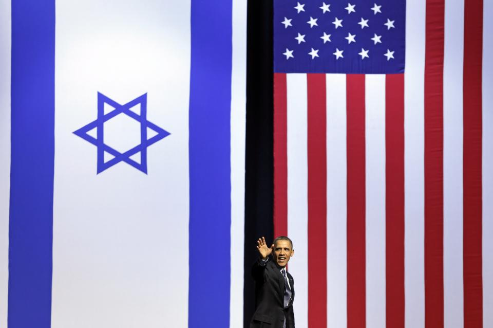 President Barack Obama waves as he leaves the stage after speaking at the International Convention Center in Jerusalem, Thursday, March 21, 2013. (AP Photo/Carolyn Kaster)