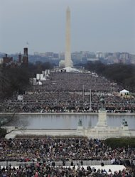 Crowds congregate in The National Mall for the ceremonial swearing-in for President Barack Obama at the U.S. Capitol during the 57th Presidential Inauguration in Washington, Monday, Jan. 21, 2013. (AP Photo/Susan Walsh)