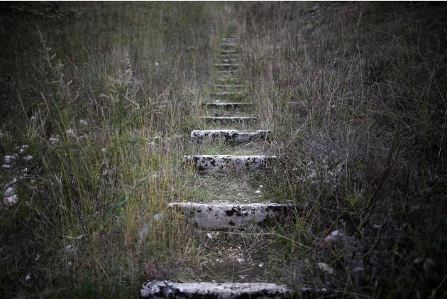 A view of worn stone steps which lead to the disused ski jump from the Sarajevo 1984 Winter Olympics on Mount Igman, near Sarajevo