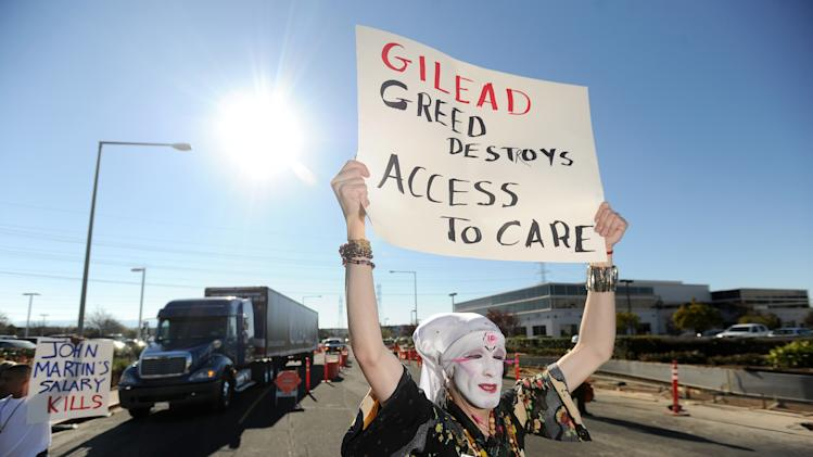 "Sister Vicious of the Sisters of Perpetual Indulgence joins about 40 protesters from across the country at Gilead Sciences headquarters in Foster City, Calif., on Wednesday, Nov. 14, 2012, calling on the drug maker to lower prices for its Stribild AIDS medication. Joined by an 18-wheel tractor trailer adorned with a ""Stop Corporate Welfare for Gilead"" sign, picketers marched through streets around the company's headquarters for about an hour. (Noah Berger /AP Images for AIDS Healthcare Foundation)"