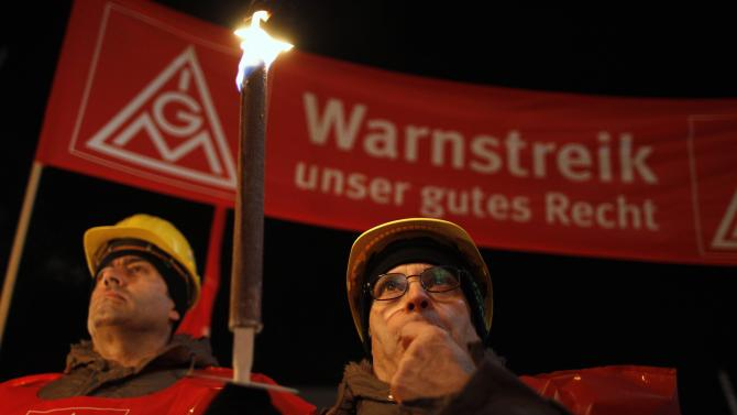 Employees of Benteler Group take part in a warning strike by IGM in front of the Benteler plant in the western city of Paderborn