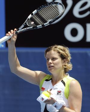 Kim Clijsters of Belgium celebrates after winning over Stephanie Foretz Gacon of France during their second round match at the Australian Open tennis championship, in Melbourne, Australia, Wednesday, Jan. 18, 2012. (AP Photo/Andrew Brownbill)