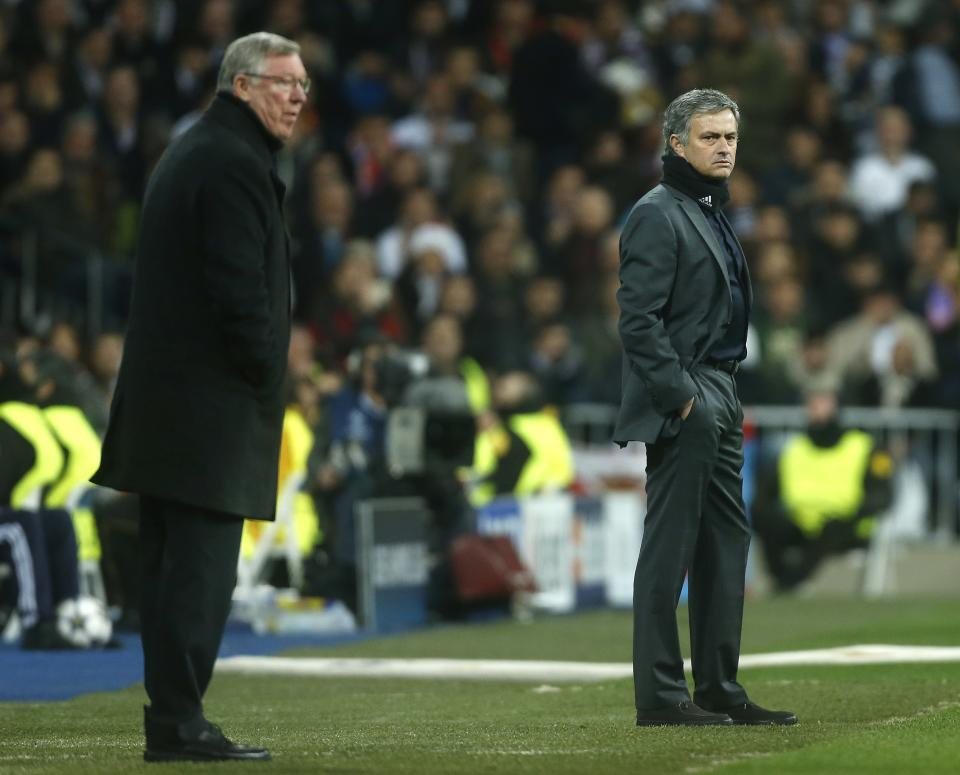 Manchester United's manager Sir Alex Ferguson, left, and Real Madrid's coach Jose Mourinho stand on the touchline during the Champions League round of 16 first leg soccer match between Real Madrid and Manchester United at the Santiago Bernabeu stadium in Madrid, Wednesday Feb. 13, 2013. (AP Photo/Andres Kudacki)