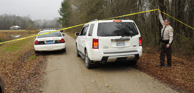 <p>               A Walker County sheriff's deputy lifts crime scene tape for investigators as National Transportation Safety Board officials continue investigate the fatal crash Tuesday night of a small plane that was reported stolen near Jasper, Ala., Wednesday, Jan. 2, 2013. Walker County sheriff's Chief Deputy James Painter says authorities are still investigating but believe the teenagers took the plane without permission before it crashed Tuesday night. (AP Photo/AL.com, Joe Songer) MAGS OUT