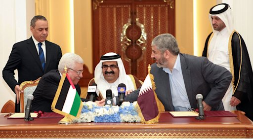 Palestinian President Mahmoud Abbas, left, shakes hands with Hamas leader Khaled Mashaal, right, as the Emir of Qatar, Sheikh Hamad bin Khalifa Al Thani, center, looks on, after signing an agreement in Doha, Qatar, Monday,  Feb 6, 2012. The main Palestinian political rivals on Monday took a major step toward healing their bitter rift, agreeing that Palestinian President Mahmoud Abbas would head an interim unity government to prepare for general elections in the West Bank and Gaza Strip. (AP Photo/Osama Faisal)