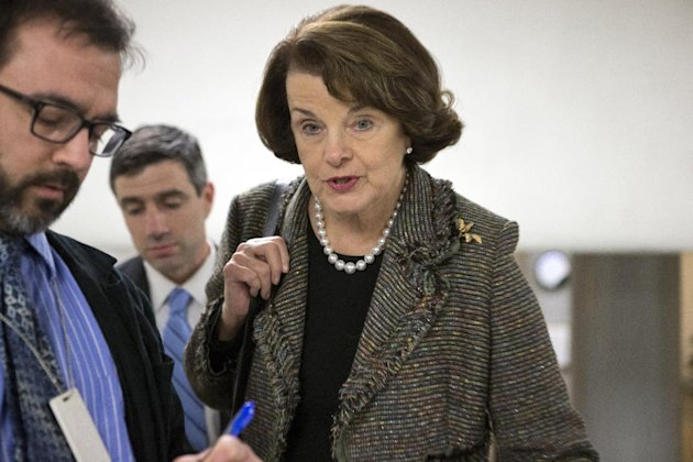 Senate Intelligence Committee Chairman Dianne Feinstein, D-Calif., is interviewed by reporters as senators return to Capitol Hill after a week away from Washington with just three legislative days unt