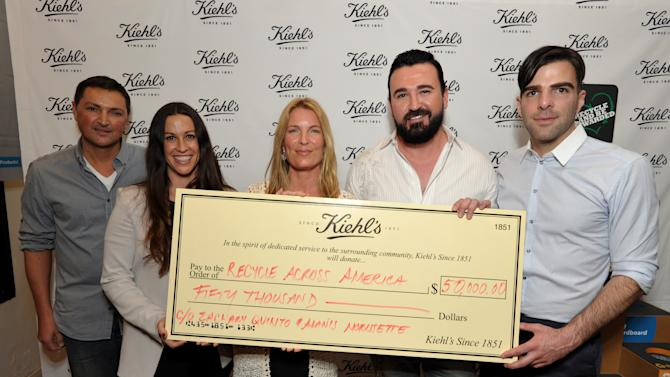 IMAGE DISTRIBUTED FOR KIEHL'S - From left, photographer Roger Moenks, musician Alanis Morissette, Mitch Hedlund, founder and executive director, Recycle Across America, Chris Salgardo, President, Kiehl's USA, and actor Zachary Quinto pose with a check presented to Recycle Across America during Kiehl's Earth Day Celebration at Kiehl's on Wednesday, April  17, 2013, in Santa Monica, Calif. (Photo by John Shearer/Invision for Kiehl's/AP Images)