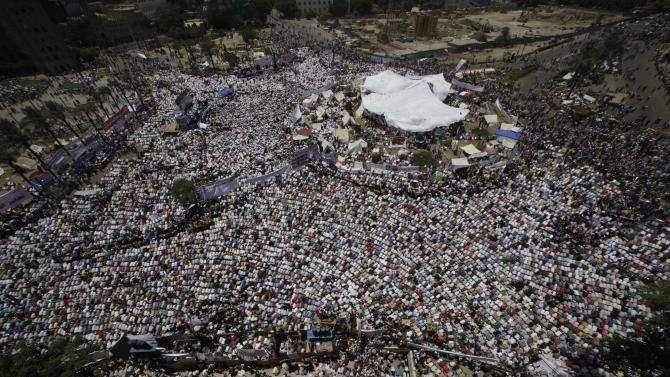 General view showing thousands of Egyptians performing Friday prayers at Tahrir Square, the focal point of the Egyptian uprising, in Cairo, Egypt, Friday, July 8, 2011. Thousands of Egyptians took to the streets around the country again on Friday to demand justice for victims of Hosni Mubarak's regime and press the new military rulers for a clear plan of transition to democracy. (AP Photo/Amr Nabil)