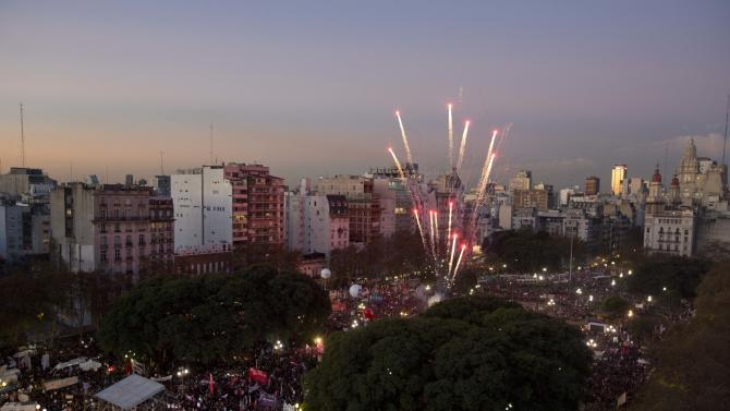 Fireworks explode over a demonstration against gender violence outside the National Congress in Buenos Aires, Argentina, Wednesday, June 3, 2015. Every 30 hours a woman is murdered in Argentina due to gender violence, according to Ada Rico from La Casa del Encuentro, an NGO that councils abused women and called for the protest. (AP Photo/Natacha Pisarenko)