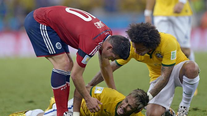 Brazil's Neymar screams out after being fouled during the World Cup quarterfinal soccer match between Brazil and Colombia at the Arena Castelao in Fortaleza, Brazil, Friday, July 4, 2014. Brazil's team doctor says Neymar will miss the rest of the World Cup after breaking a vertebrae during the team's quarterfinal win over Colombia. (AP Photo/Manu Fernandez)