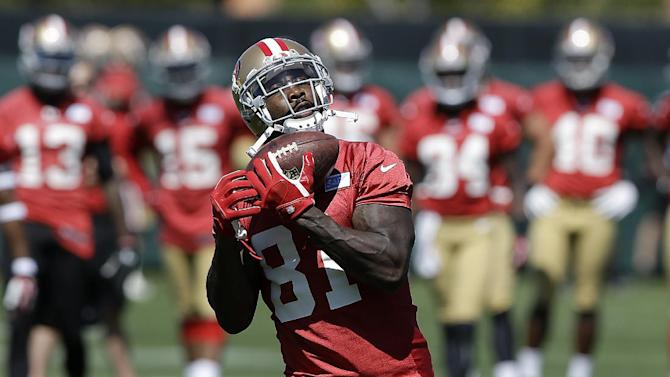 San Francisco 49ers wide receiver Anquan Boldin (81) catches a pass during NFL football mini-camp in Santa Clara, Calif., Tuesday, June 17, 2014