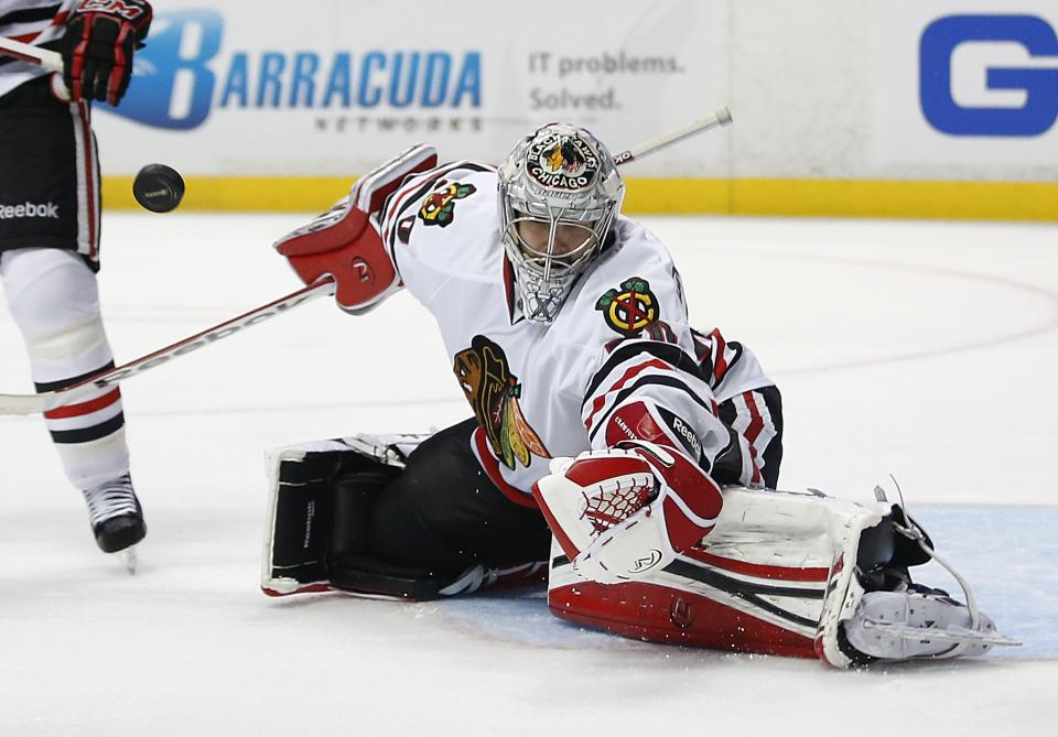 Chicago Blackhawks goalie Corey Crawford deflects a shot by the Anaheim Ducks during the second period of an NHL hockey game in Anaheim, Calif., Wednesday, March 20, 2013. (AP Photo/Jae C. Hong)