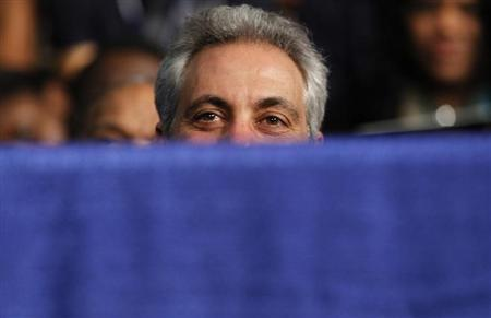 Chicago Mayor Emanuel listens as U.S. President Obama speaks in Chicago