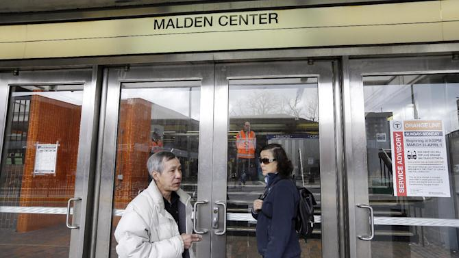 Commuters are turned away at Malden Center station in Malden, Mass. Friday, April 19, 2013 as area MBTA commuter trains are suspended. Two suspects in the Boston Marathon bombing killed an MIT police officer, injured a transit officer in a firefight and threw explosive devices at police during a getaway attempt in a long night of violence that left one of them dead and another still at large Friday, authorities said as the manhunt intensified for a young man described as a dangerous terrorist. (AP Photo/Elise Amendola)