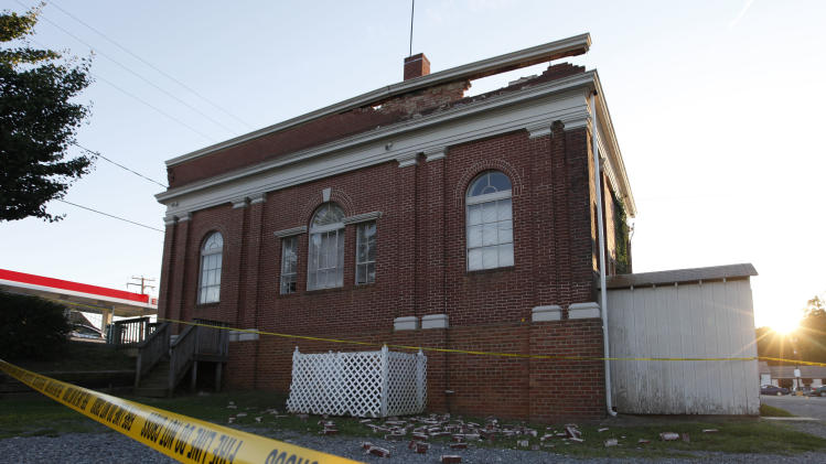 The sun sets behind a quake damaged building in Mineral, Va., a small town close to the epicenter, Tuesday, Aug. 23, 2011. It was the most powerful earthquake to strike the East Coast in 67 years, shaking buildings and rattling nerves from South Carolina to Maine. (AP Photo/Steve Helber)