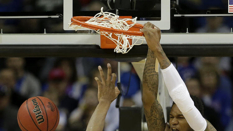 Kansas guard Ben McLemore (23) dunks the ball during the first half an NCAA college basketball game against Texas Tech in the Big 12 men's tournament Thursday, March 14, 2013, in Kansas City, Mo. (AP Photo/Charlie Riedel)
