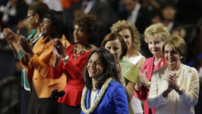 FILE - This Sept. 4, 2012 file photo, Hawaii House candidate Tulsi Gabbard is applauded by women House members at the Democratic National Convention in Charlotte, N.C. Gabbard is the first Hindu elected to Congress. Rep. Ami Bera of California, also a Democrat, is the third Indian-American to serve in the House. Gabbard, however, isn't from India, where Hinduism originated and the background shared by the vast majority of its adherents have ethnic ties. (AP Photo/Lynne Sladky, File)