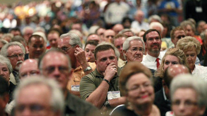 """In this June 19, 2012 photo, participants in the Southern Baptist Convention, listen during a debate about changing the name of the organization, at the convention in New Orleans. The nation's largest Protestant denomination has voted to adopt an alternative name for churches that feel the title """"Southern Baptist"""" could be a turn-off to potential believers. Although the denomination's name will officially remain Southern Baptist Convention, many delegates still opposed the optional """"Great Commission Baptists.""""  (AP Photo/Gerald Herbert)"""
