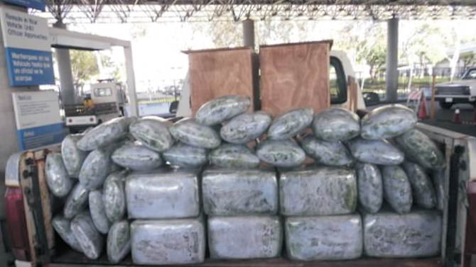 This Sept. 7, 2010, photo provided by the U.S. Immigration and Customs Enforcement shows more than 110 kg of marijuana seized from a vehicle that attempted to enter the U.S. near San Diego. The driver of this vehicle had stated he responded to a newspaper ad allegedly placed by drug smugglers to recruit drivers to unwittingly take drugs across the border. Smugglers are advertising in Mexican newspapers for jobs as security guards, housecleaners and cashiers to recruit the unemployed and underemployed to drive drug-laden vehicles into the United States. Starting this week in April 2012, U.S. Immigration and Customs and Enforcement began warning job applicants in two Tijuana newspapers that they may be unwitting targets for drug cartels. (AP Photo/U.S. Immigration and Customs Enforcement)
