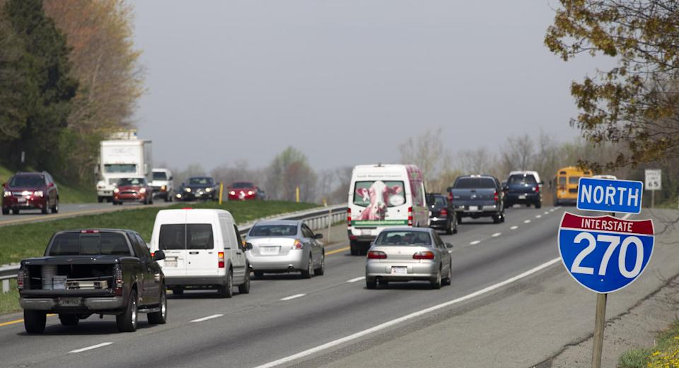 Northbound vehicles drive on Interstate 270 near Hyattstown, Md., Friday, March 23, 2012. Maryland State Police say an armored truck lost some cash on I-270 near Hyattstown.   (AP Photo/Manuel Balce Ceneta)