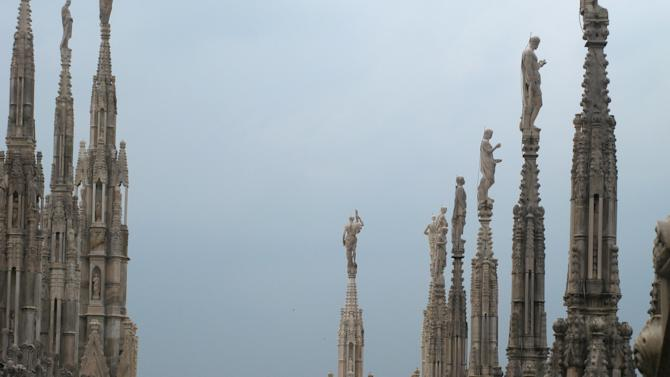 This July 6, 2012 photo shows spires of the Milan cathedral against the threatening skies in Milan, Italy. To travel through northern Italy with a copy of Mark Twain's 1869 ''The Innocents Abroad', his classic 'record of a pleasure trip'. It took him to the great sights of Europe and on to Constantinople and Jerusalem before he sailed home to New York. Such a trip would take far too big a chunk out of my holiday time. But, Milan, Florence and Venice, a mere fragment for Twain, was within my reach for a two-week vacation. (AP Photo/Raf Casert)