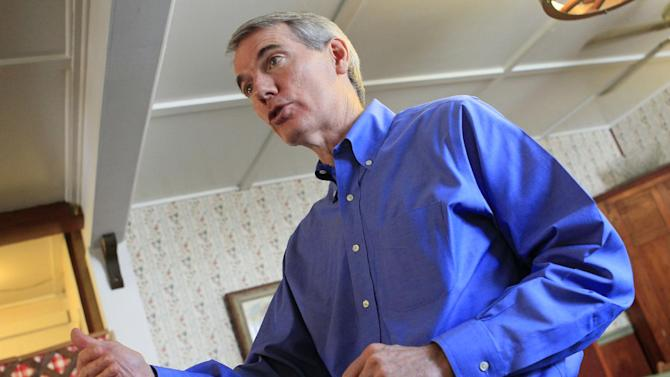 In this May 11, 2012, file photo, Sen. Rob Portman, R-Ohio, speaks to supporters at the Wayside Inn in West Union, Ohio. In a year when being perceived as bland proved not to be a hindrance in capturing the GOP presidential nomination, Portman has emerged as someone often talked about in Republican circles as a strong vice presidential choice. (AP Photo/Al Behrman)