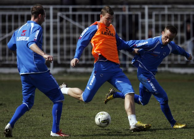 Bosnia's national soccer team players Edin Dzeko, Elvir Rahimic and Vrsajevic Avdija take part in a training session in Hrasnica