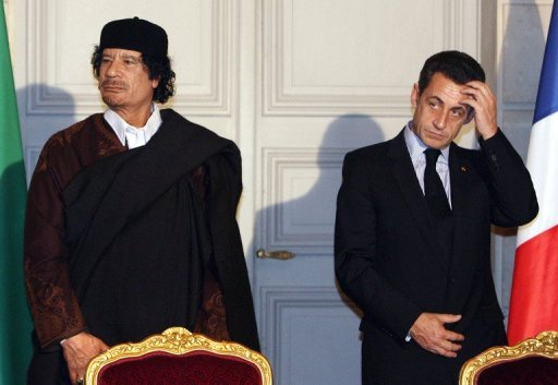 Nicolas Sarkozy (right) and Moamer Kadhafi meet to sign trade deals at the Elysee Palace in Paris in 2007. French prosecutors on Friday opened a probe into allegations Libya contributed to the 2007 campaign of Nicolas Sarkozy, who went on to become president, a judicial source said