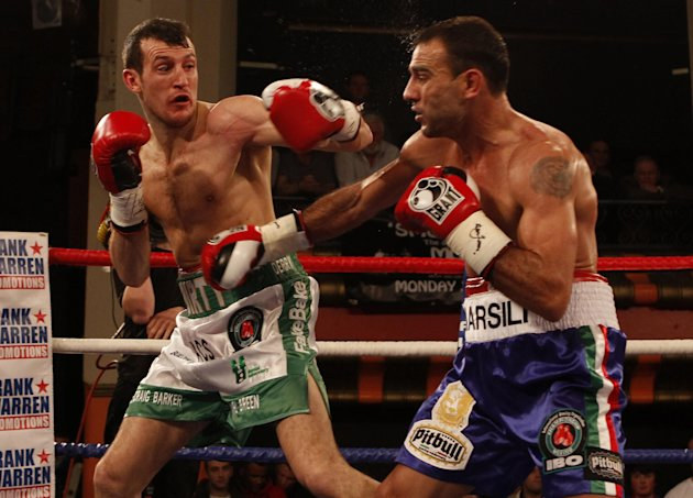 Derry Mathews, left, during his bout against Italian boxer Emiliano Marsili, right, in the IBO Lightweight Title fight at the Liverpool Olympia in Liverpool, England, Friday Jan. 20, 2012. Marsili won
