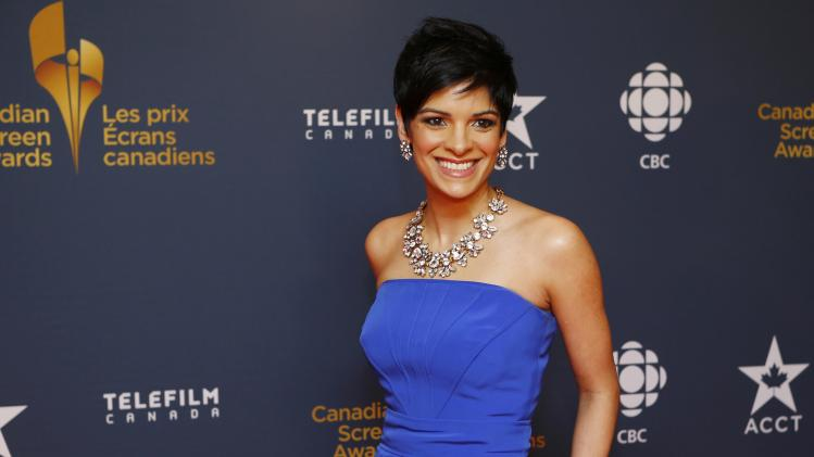 CBC News anchor Anne-Marie Mediwake arrives on the red carpet at the 2014 Canadian Screen awards in Toronto