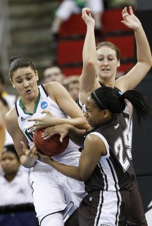 Notre Dame's Natalie Achonwa, left, struggles with St. Bonaventure's Megan Van Tatenhove, rear, and Armelia Horton, right, during the first half of an NCAA college women's tournament regional semifinal basketball game in Raleigh, N.C., Sunday, March 25, 2012. (AP Photo/Gerry Broome)