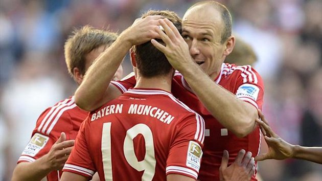 Arjen Robben and Mario Goetze celebrate for Bayern Munich (AFP)