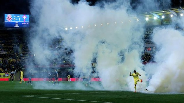 Villarreal's forward Jonathan Pereira kicks a smoke bomb thrown onto the field (AFP)