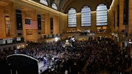 People attend Grand Central Terminal centennial celebrations in New York, February 1, 2013. Built in palatial Beaux Arts style, celebrated in movies, and narrowly saved from the wrecking ball in the 1970s, New York's Grand Central rail station turned 100 Friday
